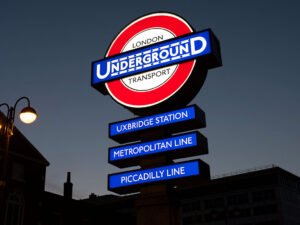 Uxbridge station heritage roundel at night